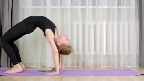 Cute young girl training at home GIF