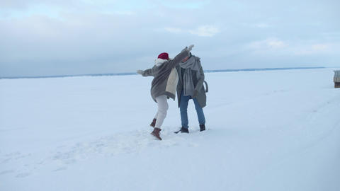 Couple spin in hug in snowy weather. Slowmotion Live Action