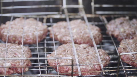Burger patties cooked Live Action