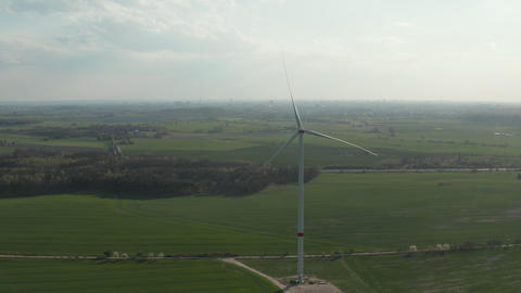 AERIAL: close up shot of wind mill rotating by the force of the wind and Live Action