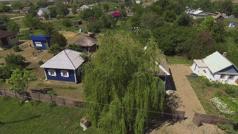 Aerial view of traditional russian country cabins houses izba in village Live Action