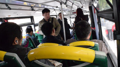 SLOW MOTION: Bus , Public Transport in Shanghai China , Asian men and woman Live Action