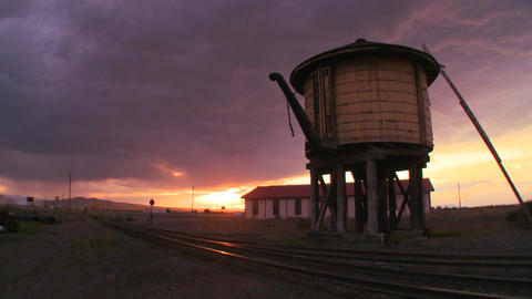 A water towers along an abandoned railroad track a Footage