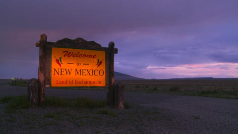 A roadside sign welcomes visitors to New Mexico Stock Video Footage