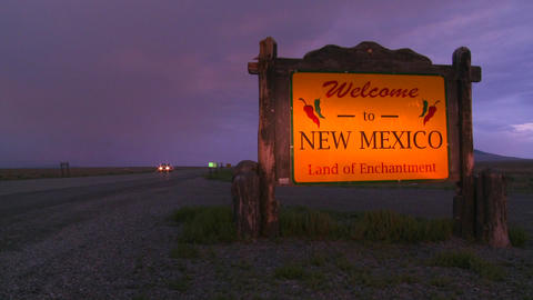A roadside sign welcomes visitors to New Mexico as Footage
