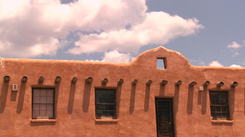 Time lapse clouds above a New Mexico adobe buildin Stock Video Footage