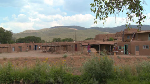 A Native American Indian girl walks near the Taos Stock Video Footage