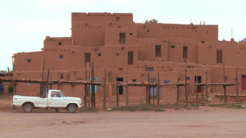 Old white pickup truck in front of the Taos pueblo Stock Video Footage
