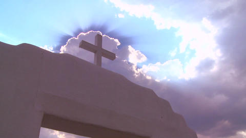 A Christian cross glows against a heavenly sky Stock Video Footage