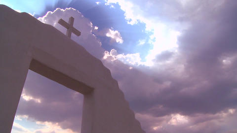 A Christian cross glows against a heavenly sky Footage