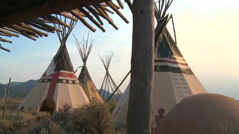 Indian teepees stand in a native american encampme Footage
