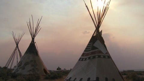 Indian teepees stand in a native american encampme Stock Video Footage