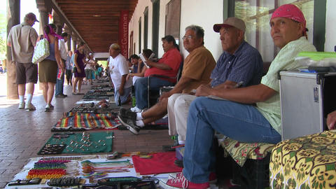 Native Americans sell their crafts and wares to to Stock Video Footage