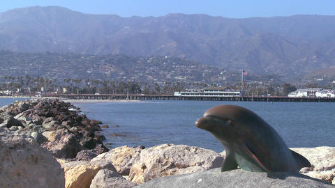 A dolphin sculpture graces the entrance to Santa B Stock Video Footage