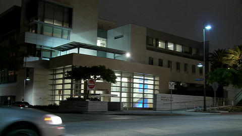 Establishing shot of a police station at night Stock Video Footage