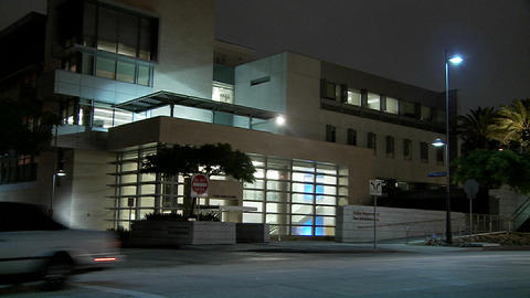 Establishing shot of a police station at night Footage