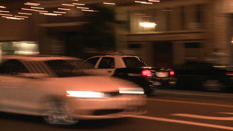 A police car drives on a downtown Los Angeles stre Stock Video Footage