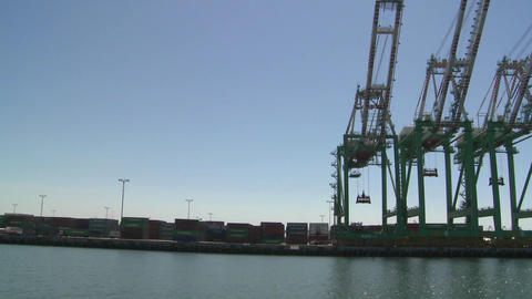 POV from boat of cranes and port at Long Beach har Stock Video Footage