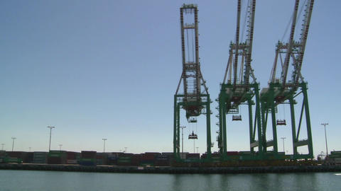 POV from boat of cranes and port at Long Beach har Footage