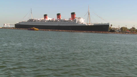 POV from a boat near the Queen Mary in Long Beach Stock Video Footage