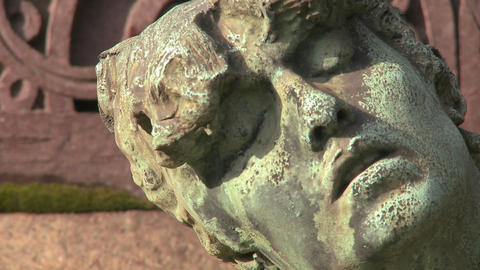 A sculpture in a cemetery seems to be suffering Footage
