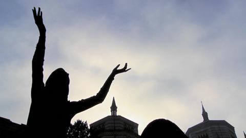 Clouds sweep over a statue in a cemetery in time l Stock Video Footage