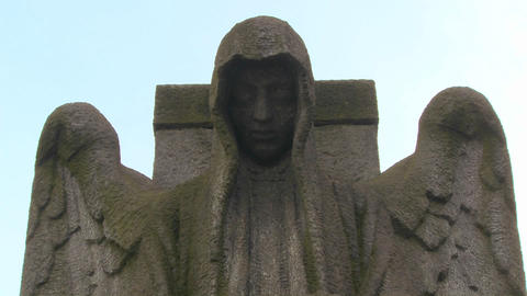 A ghostly angel looks down on a grave from above Stock Video Footage