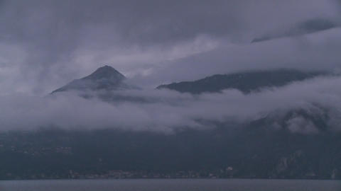 Time lapse of fog rolling over mountains Stock Video Footage
