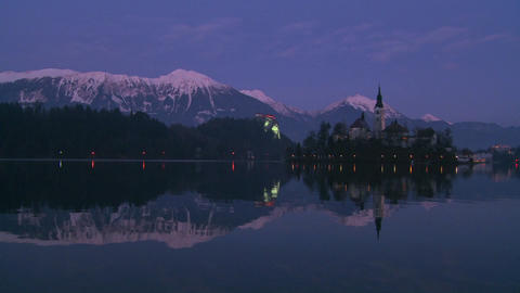 A small church on an island at dawn at Lake Bled, Stock Video Footage