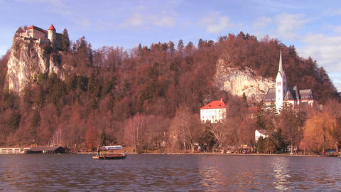 A boat passes a beautiful medieval castle and chur Footage