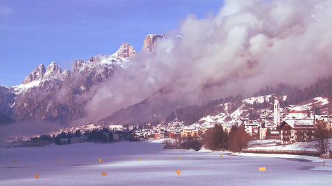 A distant snowbound village in the Alps in Austria Stock Video Footage