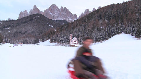 People go sledding in the Swiss Alps Stock Video Footage