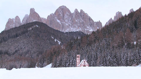 A beautiful church is nestled in the Alps Stock Video Footage