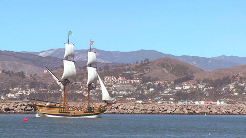 A tall master schooner sails into Ventura harbor Footage