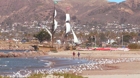 A tall master schooner sails into Ventura harbor Stock Video Footage