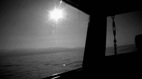 A boat is traversing the calm waters off the coast near... Stock Video Footage