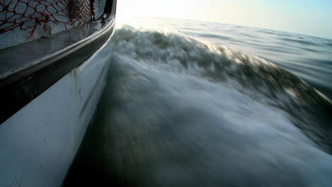 A boat moves along, churning up the water Footage