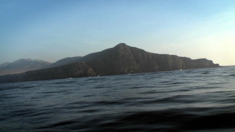 A boat passes through the water, with other boats and... Stock Video Footage