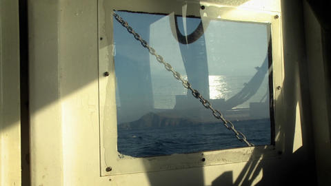 An island is viewed through a boat window Footage