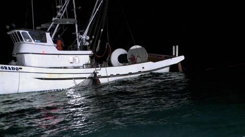 A couple of crew members work on the deck of a fishing... Stock Video Footage