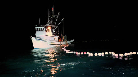 A fishing vessel spreads out a net Stock Video Footage