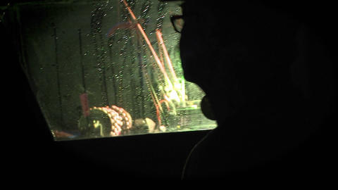 A man looks through a boat window as the rain falls Footage