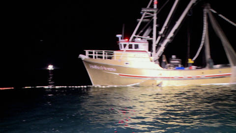 A fishing boat has set out nets in the water Stock Video Footage
