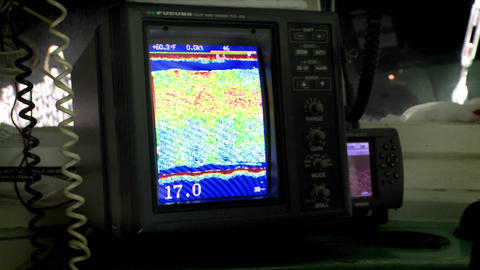 A fishing vessel uses a sonar device to find fish Stock Video Footage