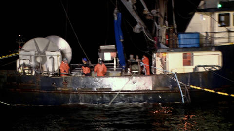 Several men work at night on a ship Stock Video Footage