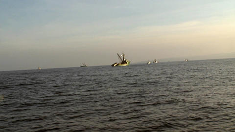 Several fishing vessels navigate at sea Stock Video Footage
