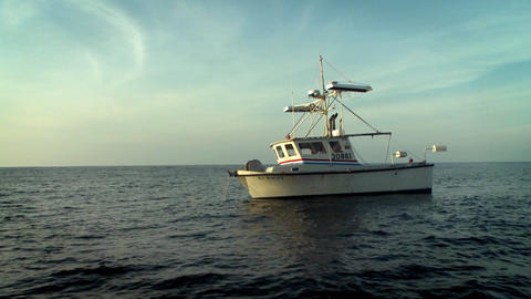 A fish-cutter navigates on the open seas Stock Video Footage
