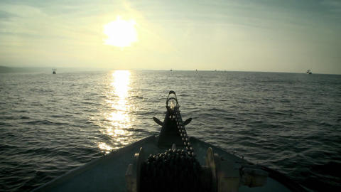 A boat moves through the water as the sun sets Stock Video Footage