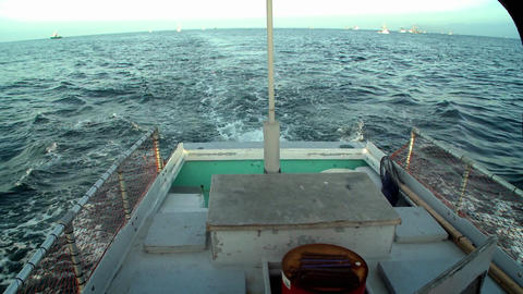 A boat sails through the water Stock Video Footage