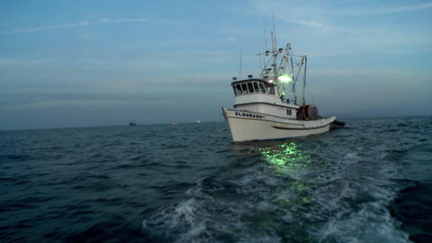 A boat travels through the water Stock Video Footage